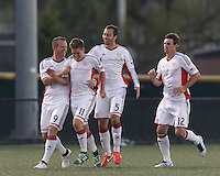 New England Revolution substitute midfielder Kelyn Rowe (11) celebrates his goal with teammates.  2013 Lamar Hunt U.S Open Cup fourth round, New England Revolution (white) defeated New York Red Bulls (blue/yellow), 4-2, at Harvard University's Soldiers Field Soccer Stadium on June 12, 2013.