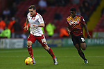 Sheffield United's Billy Sharp escapes Greg Leigh of Bradford - Sheffield United vs Bradford City - Skybet League One - Bramall Lane - Sheffield - 28/12/2015 Pic Philip Oldham/SportImage