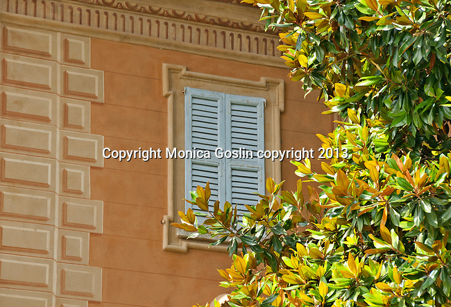 Painted house and window of a villa in the Lake Como town of Carate Urio, Italy