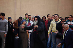 Priest David, the head of Mar Mina church arrives to the site of a gun attack on Mar Mina church in Helwan district on the outskirts of Cairo, on December 29, 2017. A gunman opened fire on a church, killing at least nine people before policemen shot him dead, state media and officials said. Photo by Amr Sayed