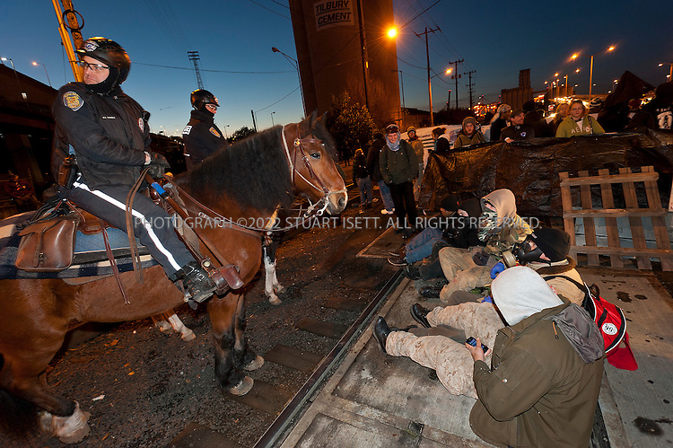 12/12/2011--Seattle, WA..Occupy Seattle, an off-shoot of the Occupy Wall Street movement, organized a protest Monday, December 12th, to block the Port of Seattle as part of a West Coast coordinated action in San Diego, Los Angeles, Oakland, Portland, Tacoma, Vancouver, B.C., and Houston. The 'Port shut down' protest was not endorsed by any of the maritime unions including the International Longshore and Warehouse Union (ILWU) which has been in a bitter labor despite in Westport, Washington...Here:  protesters block one of the entrances to the Port of Seattle...©2011 Stuart Isett. All rights reserved.