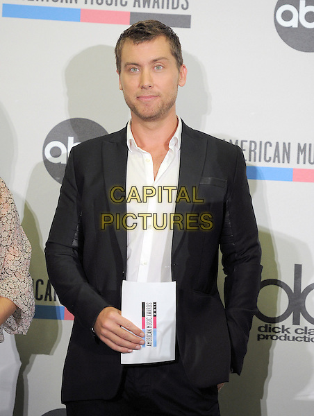 Lance Bass.2011 American Music Awards Nominee Press Conference held at the JW Marriott LA Live Hotel, Los Angeles, California, USA..October 11th, 2011.half length black suit white shirt.CAP/RKE/DVS.©DVS/RockinExposures/Capital Pictures.