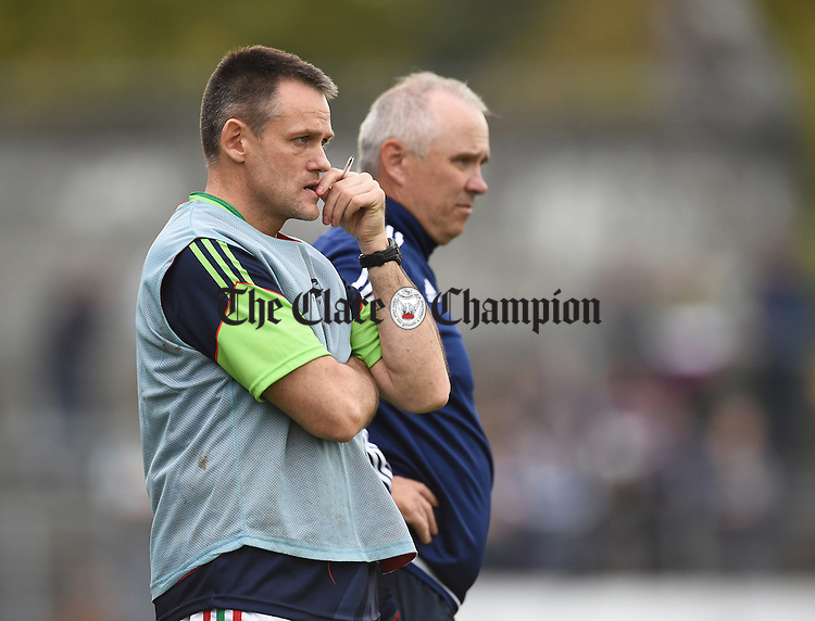 Kilmurry Ibrickane selector Odhran O Dwyer and manager Aiden Moloney on the sideline against Cratloe during their county final in Cusack park. Photograph by John Kelly.