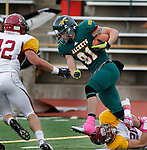 OCTOBER 4, 2014 -- Alex Anderson #81 of Black Hills State tries to escape Dustin Rivas #20 of Colorado Mesa as Blake Nelson #42 of Colorado Mesa closes in during their Rocky Mountain Athletic Conference game Saturday at Lyle Hare Stadium in Spearfish, S.D.  (Photo by Dick Carlson/Inertia)