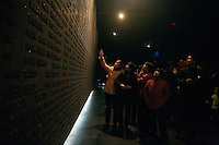 Visitors look at the names of victims of the Nanjing Massacre in the museum at the Memorial Hall of the Nanjing Massacre in Nanjing, Jiangsu, China on Dec. 13, 2009.  On Dec. 13, 2009, thousands of people visited The Memorial Hall of the Nanjing Massacre in Nanjing, Jiangsu, China, to remember those who died at the hands of Japanese soldiers in 1937-8.  The day marked the 72nd anniversary of the start of the massacre. The historical account has always been mired in controversy, and differing opinions on what actually happened have been a consistent obstacle to relations between China and Japan.  China's official account of history states that 300,000 people were killed by Japanese forces over a 6-week period starting Dec. 13, 1937