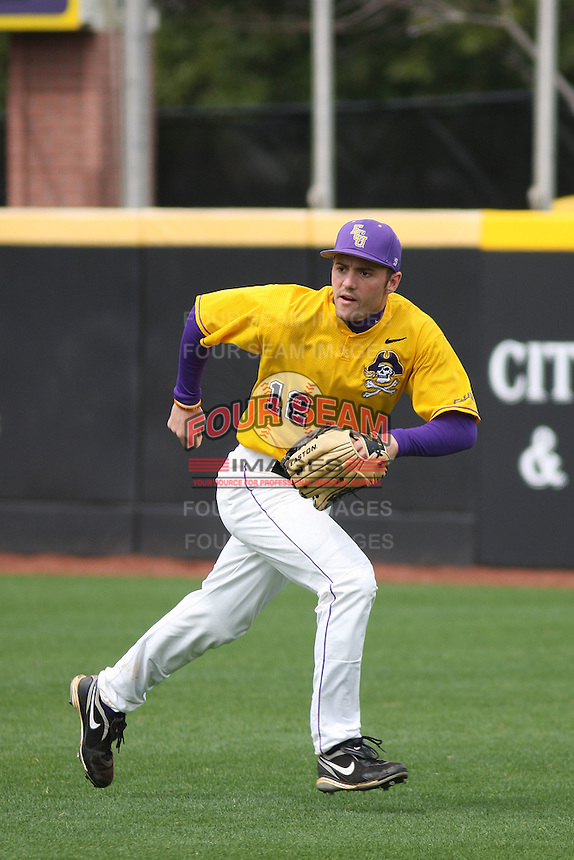 East Carolina University Pirates outfielder Jay Cannon #12 in the outfield before a game against the Stony Brook Seawolves  at Clark-LeClair Stadium on March 4, 2012 in Greenville, NC.  East Carolina defeated Stony Brook 4-3. (Robert Gurganus/Four Seam Images)