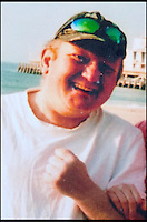 BNPS.co.uk (01202) 558833<br /> Picture: Collect/BNPS<br /> <br /> Andrew Young at Bournemouth Beach, Dorset.<br /> <br /> Andrew Young, 40, became embroiled in an argument with Victor Ibitoye after he blasted him for riding his bike on the pavement.Just seconds after the altercation Mr Young was approached by Mr Ibitoye's friend, Lewis Gill, who launched a horrific attack on the Asperger's Syndrome sufferer.Shocking CCTV footage shows Gill, aged 20, throw a punch at Mr Young that was so forceful he was flung off the pavement and onto the road, striking his head.The callous thug is then seen walking away from the man as he lay lifeless on the ground.He was rushed from the scene in Bournemouth, Dorset, to Southampton General Hospital in Hampshire where he died the next day.A post mortem found no injuries to suggest that the vulnerable victim had tried to defend himself.Gill pleaded guilty to one count of manslaughter at Salisbury Crown Court and was jailed for four years and six months.