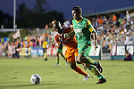 14 September 2013: Tampa Bay's Stuart Campbell (4) and Carolina's Julius James (TRI) (behind). The Carolina RailHawks played the Tampa Bay Rowdies at WakeMed Stadium in Cary, North Carolina in a North American Soccer League Fall 2013 Season regular season game. The game ended in a 2-2 tie.