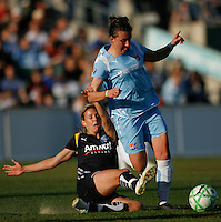 Aly Wagner (4) of the Los Angeles Sol tackles Meghan Schnur (12) of Sky Blue FC. The Los Angeles Sol defeated Sky Blue FC 2-0 during a Women's Professional Soccer match at TD Bank Ballpark in Bridgewater, NJ, on April 5, 2009. Photo by Howard C. Smith/isiphotos.com