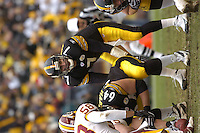 28 November 2004:  Ben Roethlisberger (7) under center Jeff Hartings (64).<br />
