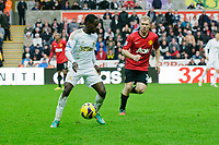 Sunday, 23 November 2012<br /> <br /> Pictured: Nathan Dyer of Swansea City and Paul Scholes of Manchester United<br /> <br /> Re: Barclays Premier League, Swansea City FC v Manchester United at the Liberty Stadium, south Wales.
