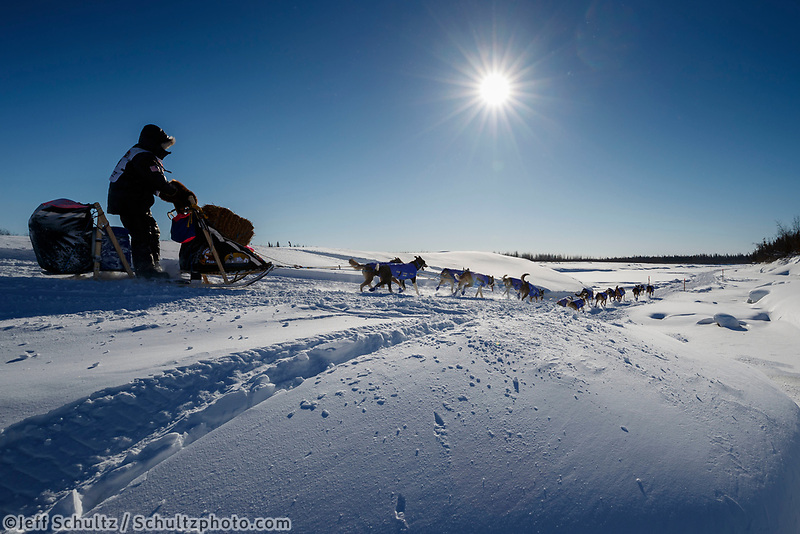 Wade Marrs runs on the trail along the Tanana river between Fairbanks and Nenana during the 2017 Iditarod on Monday March 6, 2017.<br /> <br /> Photo by Jeff Schultz/SchultzPhoto.com  (C) 2017  ALL RIGHTS RESVERVED