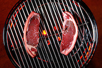 Buffalo steaks on grill.