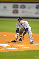 Jacksonville Suns first baseman Mark Canha #33 fields a ground ball during a game against the Pensacola Blue Wahoos on April 15, 2013 at Pensacola Bayfront Stadium in Pensacola, Florida.  Jacksonville defeated Pensacola 1-0 in 11 innings.  (Mike Janes/Four Seam Images)