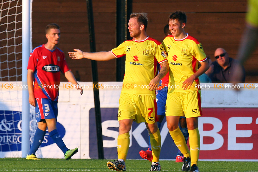 Danny Green of MK Dons is congratulated after scoring the opening goal - Dagenham and Redbridge vs MK Dons, pre season friendly - 22/07/14 - MANDATORY CREDIT: Dave Simpson/TGSPHOTO - Self billing applies where appropriate - 0845 094 6026 - contact@tgsphoto.co.uk - NO UNPAID USE