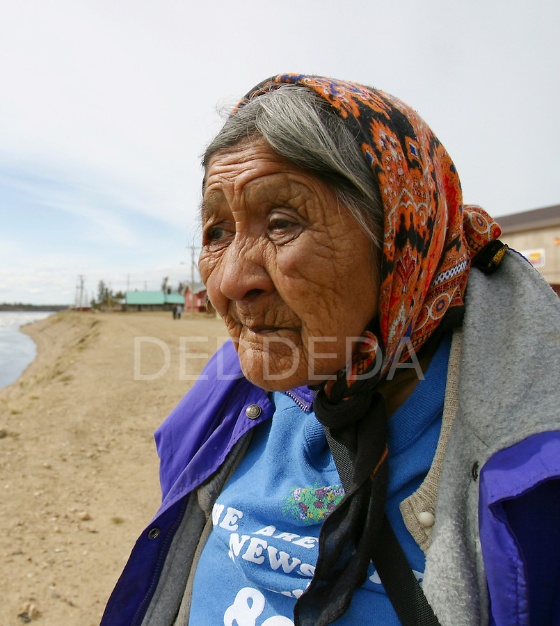 Elder Edith Josie, an elder in the Vuntut Gwitchin First Nation, stands along the banks of the Porcupine River in Old Crow, Yukon Territory, Canada..
