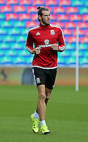 CARDIFF, WALES - SEPTEMBER 05: Gareth Bale warms up prior to the Wales training session, ahead of the UEFA Euro 2016 qualifier against Israel, at the Cardiff City Stadium on September 5, 2015 in Cardiff, Wales.
