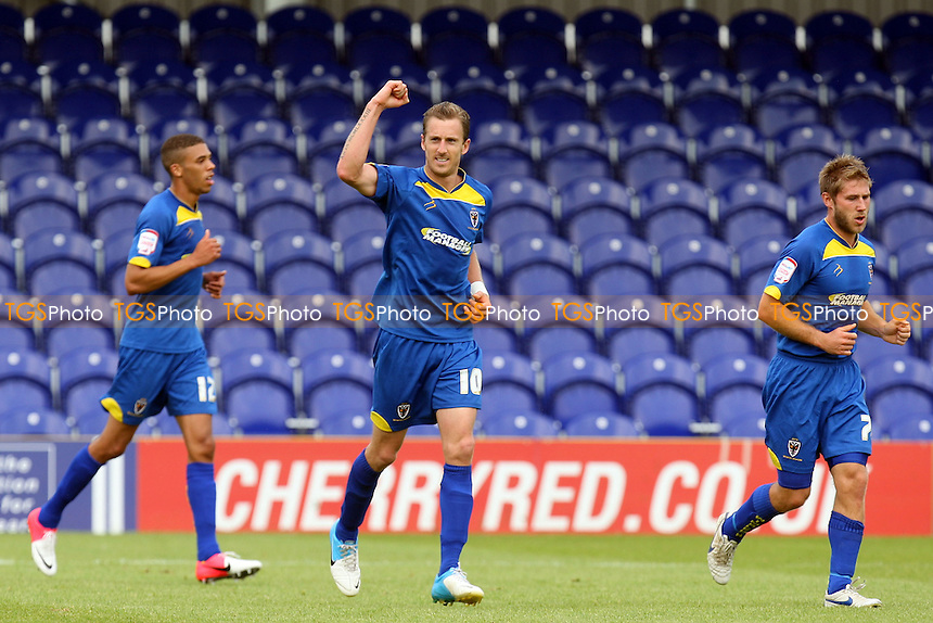Jack Midson of AFC Wimbledon celebrates scoring the opening Wombles goal -  AFC Wimbledon vs Dagenham and Redbridge at the Cherry Red Records Stadium  - 01/09/12 - MANDATORY CREDIT: Dave Simpson/TGSPHOTO - Self billing applies where appropriate - 0845 094 6026 - contact@tgsphoto.co.uk - NO UNPAID USE.