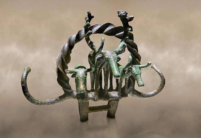"""Bronze Age Hattian ceremonial standard known as """"Sun Disks"""" from Bronze Age grave BM (2500 BC to 2250 BC), possibly a Royal grave - Alacahoyuk - Museum of Anatolian Civilisations, Ankara, Turkey. Against a warm art background"""