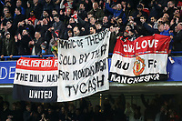 Manchester United fans display a banner 'Magic of the Cup, sold by the FA for Monday night TV Cash' during Chelsea vs Manchester United, Emirates FA Cup Football at Stamford Bridge on 18th February 2019