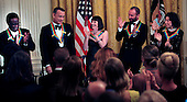 From left to right: Al Green, Tom Hanks, Patricia McBride, Sting, and Lily Tomlin applaud one another during the reception where United States President Barack Obama recognized the 37th Kennedy Center Honorees in the East Room of the White House in Washington, D.C. on Sunday, December 7, 2014.  <br /> Credit: Dennis Brack / Pool via CNP