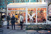 The American Eagle Outfitters pop-up shop is nestled in Bryant Park in New York, seen on Friday, November 20, 2015. American Eagle Outfitters recently purchased Tailgate Clothing, the label of designer Todd Snyder giving the company access to both high end men's design and its  dying teen apparel line. (© Richard B. Levine)