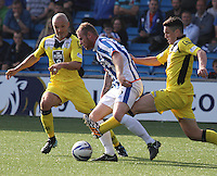 Player/Coach Jim Goodwin (left) and John McGinn combine to tackle Mark Connolly in the Kilmarnock v St Mirren Scottish Professional Football League Premiership match played at Rugby Park, Kilmarnock on 13.9.14.