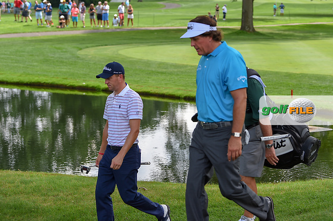 Justin Thomas (USA) and Phil Mickelson (USA) approach the green on 3 during 1st round of the World Golf Championships - Bridgestone Invitational, at the Firestone Country Club, Akron, Ohio. 8/2/2018.<br /> Picture: Golffile | Ken Murray<br /> <br /> <br /> All photo usage must carry mandatory copyright credit (© Golffile | Ken Murray)