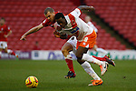 Barnsley v Blackpool<br /> 18.1.2014<br /> Sky Bet Championship<br /> Picture Shaun Flannery/Trevor Smith Photography<br /> Barnsley's Stephen Dawson battles with Blackpool's Isaiah Osbourne.