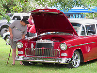 Westside Eagle Observer/RANDY MOLL Large numbers of people came out to the car show on Saturday in Highfill which was held at the Holland Barn venue as a fundraiser to support local veteran groups.
