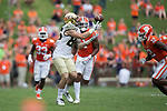 Jack Freudenthal (86) of the Wake Forest Demon Deacons catches a pass between Clemson Tigers defenders Isaiah Simmons (11) and K'Von Wallace (12) during fourth quarter action at Memorial Stadium on October 7, 2017 in Clemson, South Carolina.  The Tigers defeated the Demon Deacons 28-14. (Brian Westerholt/Sports On Film)