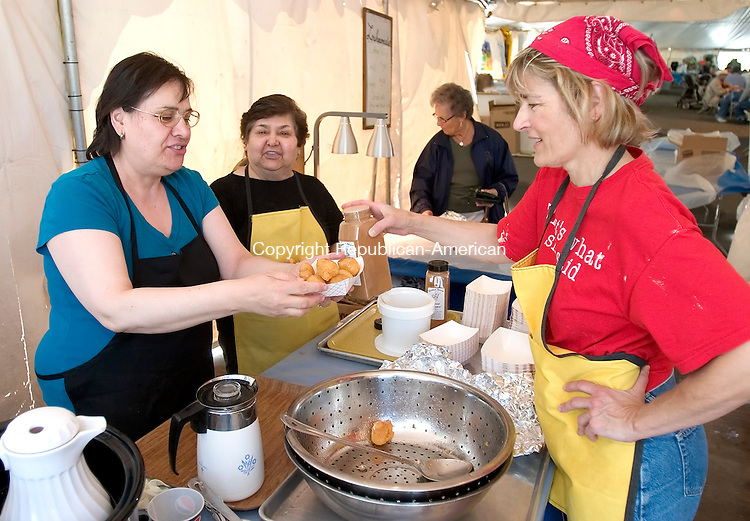 "WATERBURY, CT. 06 May 2010-050610SV07--From left, Tina Velezis of Cheshire, Soula Stambouloglou of Wolcott, and Eleni Tinios of Waterbury make and order of Loukoumaees ""Honey Puffs"" at the 38th annual Greek Festival held at the Holy Trinity Greek Church in Waterbury Thursday.  Steven Valenti Republican-American"