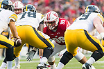 Wisconsin Badgers defensive lineman Olive Sagapolu (99) lines up during an NCAA College Big Ten Conference football game against the Iowa Hawkeyes Saturday, November 11, 2017, in Madison, Wis. The Badgers won 38-14. (Photo by David Stluka)