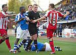 St Johnstone v Kilmarnock....20.10.12      SPL.Ref Brian Colvin separates Nigel Hasselbaink and Liam Kelly after Kelly fouled Gregory Tade.Picture by Graeme Hart..Copyright Perthshire Picture Agency.Tel: 01738 623350  Mobile: 07990 594431
