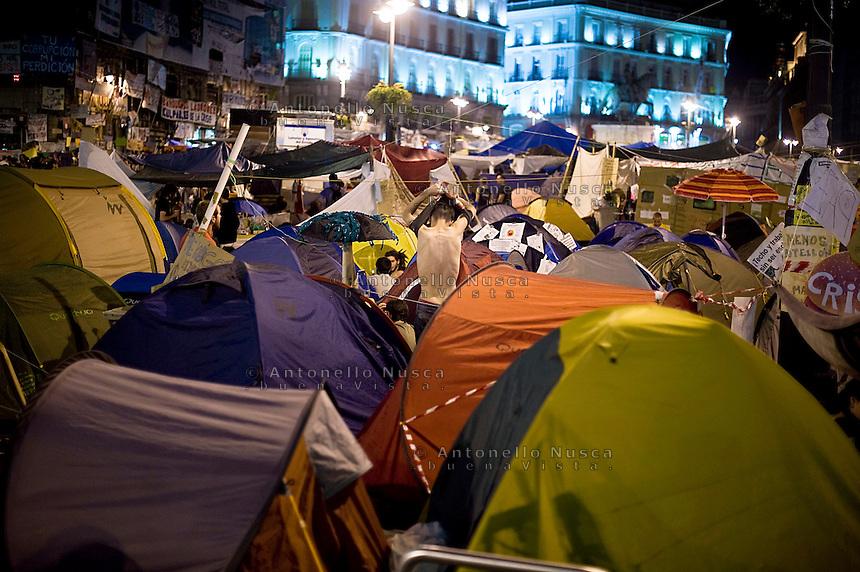 Los Indignados, the Spanish youth movement, continue demonstrating against unemployment and mainstream politics. The tent camp in Plaza del Sol..Los Indignados continuano la loro protesta in Plaza del Sol a Madrid.