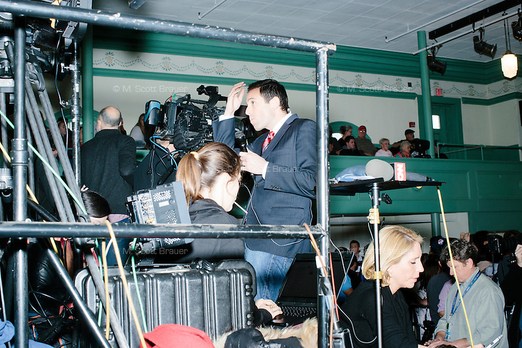 A television reporter prepares for a broadcast before real estate mogul and Republican presidential candidate Donald Trump speaks at a rally at Exeter Town Hall in Exeter, New Hampshire, on Thurs., Feb. 4, 2016.