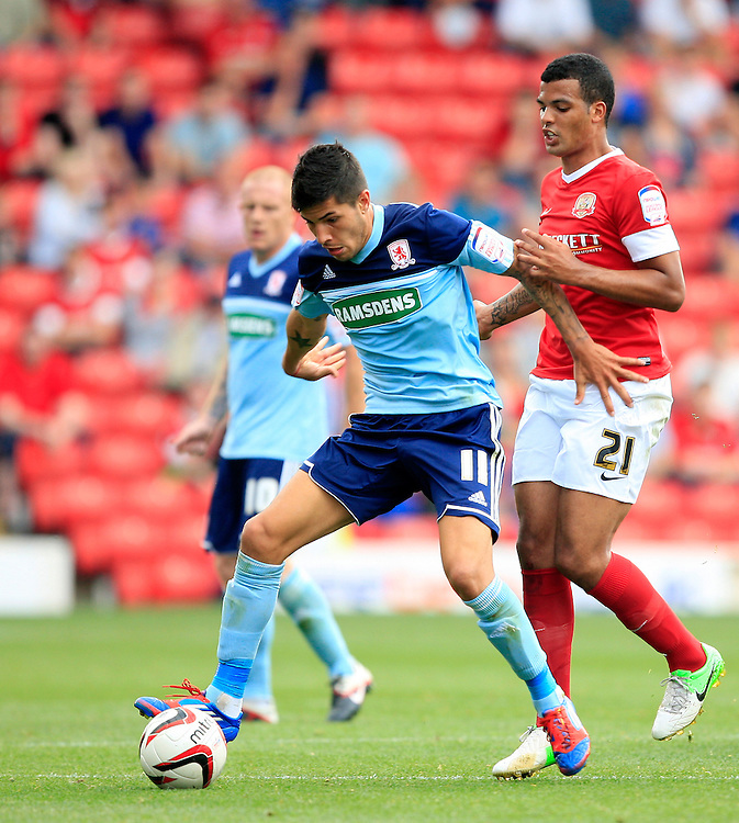 Barnsley's Jacob Mellis and Middlesbrough's Emanuel Jorge Ledesma challenge for the ball..Football - npower Football League Championship - Barnsley v Middlesbrough - Saturday 18th August 2012 - Oakwell Stadium - Barnsley..