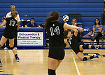 Marymount's Ashley Cabrera gets a dig in a college volleyball game, in Arlington, Vir., on Saturday, Nov. 1, 2014.<br /> Photo by Cathleen Allison