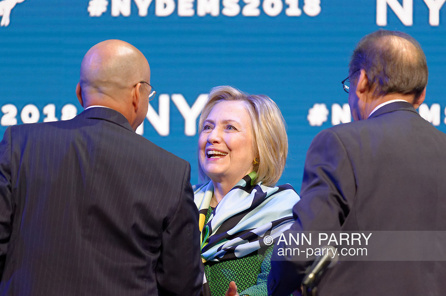 Hempstead, New York, USA. May 23, 2018. HILLARY CLINTON greets GEOFF BERMAN, Executive Director of New York State Democratic Committee, as she goes on stage to deliver Keynote Address during Day 1 of New York State Democratic Convention, held at Hofstra University on Long Island.