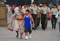 Aug. 6, 2008; Beijing, CHINA; Visitors walk in front of a formation of paramilitary policeman outside the Forbidden City in Beijing. The Olympics begin at 8pm on August 8, 2008. Mandatory Credit: Mark J. Rebilas-