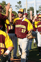 March 7, 2010:  Matt Faiman (37) of the Central Michigan Chippewas leads the congratulations after a game at Jay Bergman Field in Orlando, FL.  Central Michigan defeated Central Florida by the score of 7-4.  Photo By Mike Janes/Four Seam Images