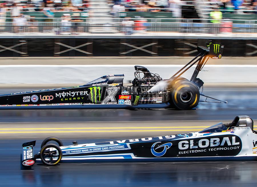 Jul 30, 2017; Sonoma, CA, USA; NHRA top fuel driver Shawn Langdon (near) races alongside Brittany Force during the Sonoma Nationals at Sonoma Raceway. Mandatory Credit: Mark J. Rebilas-USA TODAY Sports
