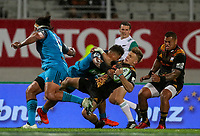 Damian McKenzie of the Chiefs is tackled during the Super Rugby Match between the Blues and the Chiefs at Eden Park in Auckland, New Zealand on Friday, 26 May 2017. Photo: Simon Watts / www.lintottphoto.co.nz