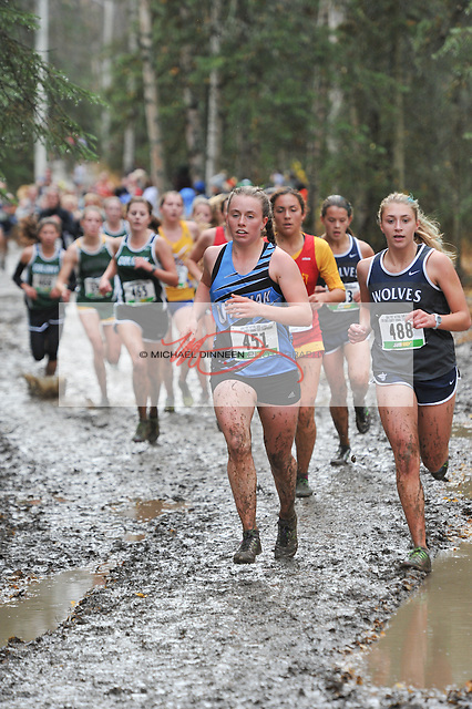 Chugiak's Clare Cook and Eagle River's Summer Frazier lead a group of runners in Saturday's championships.  Photo for the Star Michael Dinneen