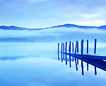 Early morning mist over Derwent Water, Lake District, Cumbria.