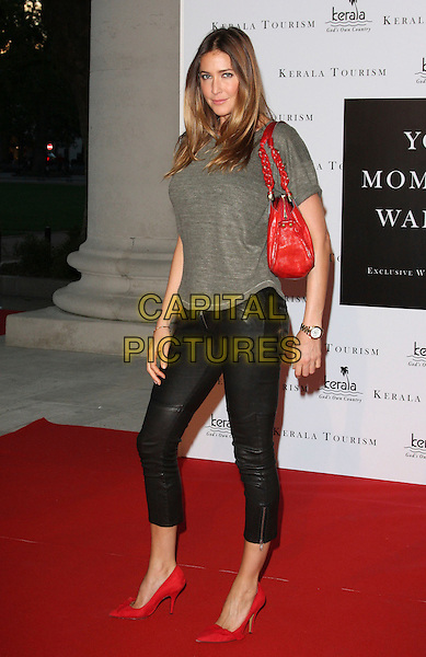 LISA SNOWDON.Your Moment Is Waiting - launch party at Saatchi Gallery, London, England..September 21st 2010.full length leather trousers cropped grey gray top red bag purse shoes .CAP/ROS.©Steve Ross/Capital Pictures