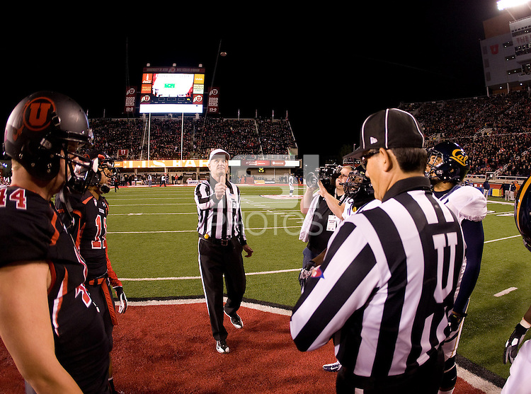 California and Utah captains watch referee Terry Leyden tosses a coin during coin toss ceremony before the game at Rice-Eccles Stadium in Salt Lake City, Utah on October 27th, 2012.   Utah Utes defeated California, 49-27.