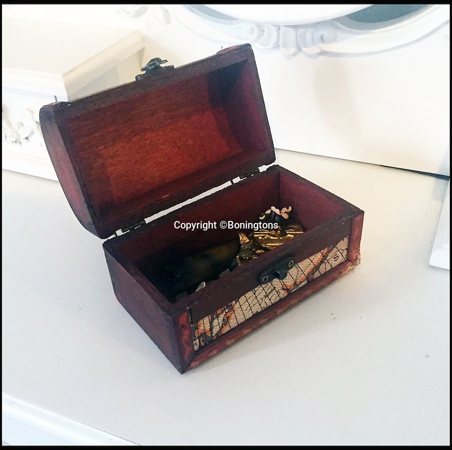 BNPS.co.uk (01202 558833)<br /> Pic: Boningtons/BNPS<br /> <br /> The treasure box in the vendors son's bedroom.<br /> <br /> Shiver me timbers...A toy pirates treasure chest throws up real gold coin worth £250,000.<br /> <br /> A labourer is set to reap a life-changing £250,000 windfall after discovering the rarest British coin ever made - in his four-year-old son's toy treasure chest.<br /> <br /> The 35-year-old had been given the 'lost' 300 year old Queen Anne Vigo five guinea coin by his late grandfather 30 years ago to play pirate games with.<br /> <br /> After he bought his own son a treasure chest he dug the coin out and gave it to him to play with before having an auctioneer have a look at it.<br /> <br /> It is to be sold by Essex auctioneers Bonningtons.