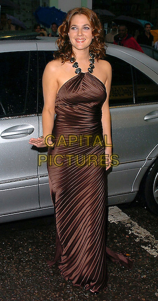 "DREW BARRYMORE.""The Perfect Catch"" (formerly ""Fever Pitch"")- VIP screening at The Electric Cinema, London, W10..July 27th, 2005.full length brown silk satin dress pleated halterneck hand.www.capitalpictures.com.sales@capitalpictures.com.©Capital Pictures"
