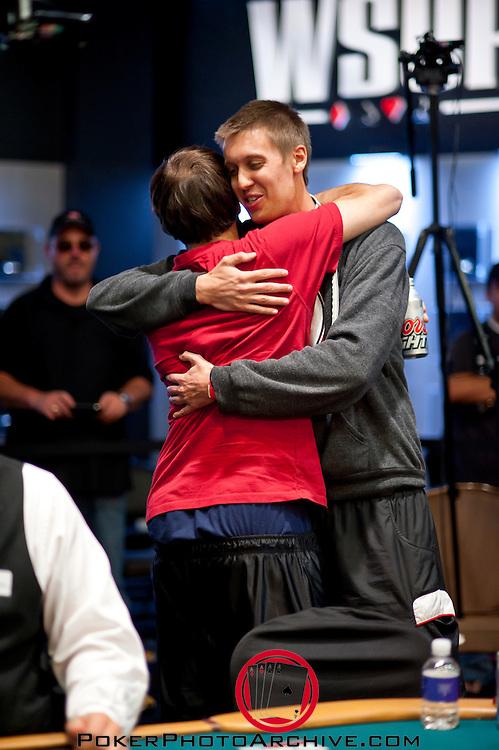Brent Hanks gets a hug from Jason Mercier,